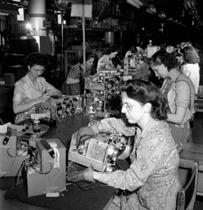 Production line women working on the underside of wireless sets no. 19