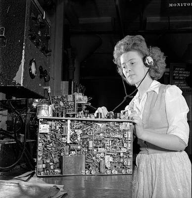 Woman testing audio of a wireless set no. 19